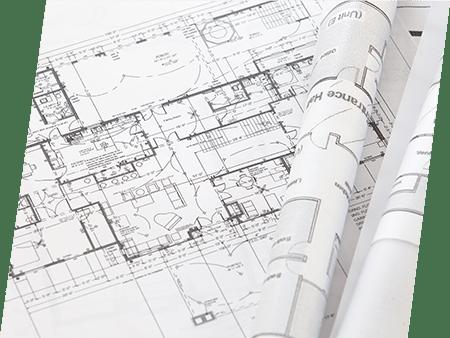 Photographie de plans d'étude du bâtiment. ATCE Énergie, spécialisée dans les installations de chauffage, ventilation, climatisation et plomberie, à Aix en Provence.